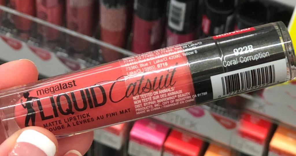hand holding wet n wild liquid catsuit lipstick