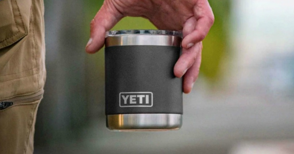 Man carrying a small YETI cup with lid