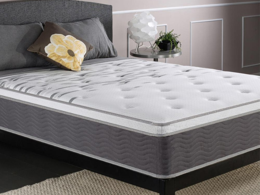 mattress on bed frame in bedroom