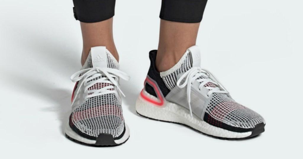 person wearing adidas Ultraboost