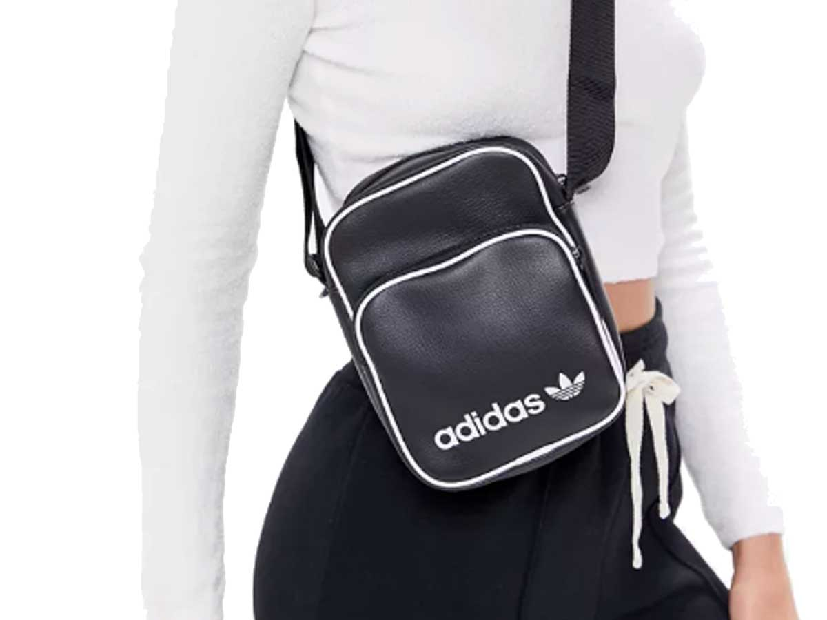woman wearing brand name cross over bag