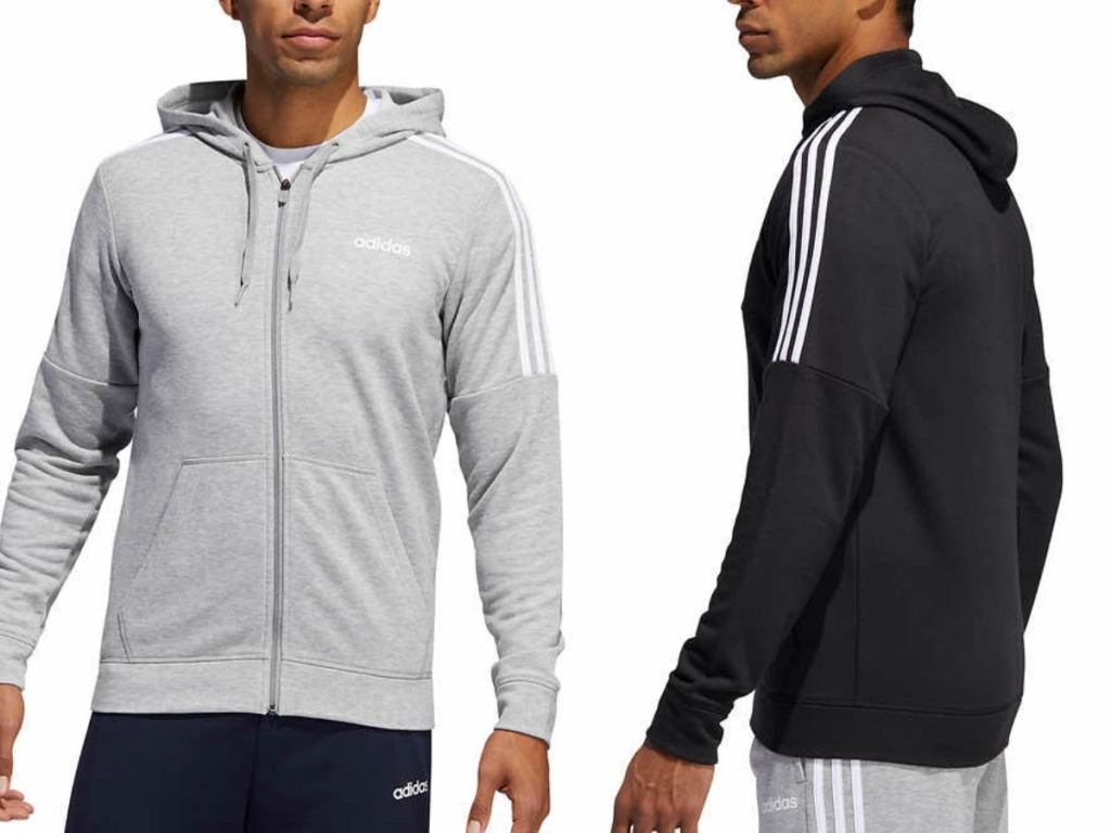 two men wearing zip up sweatshirts on white backgroun