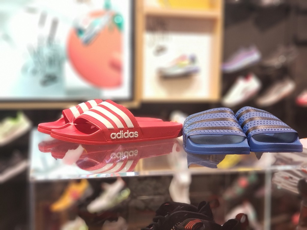 pink and blue adidas slides in-store