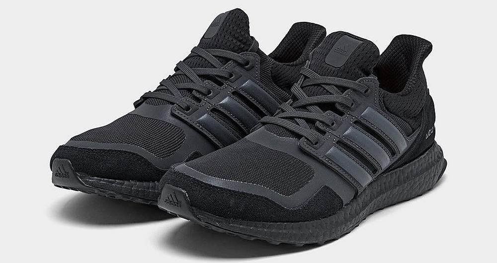 pair of black adidas sneakers