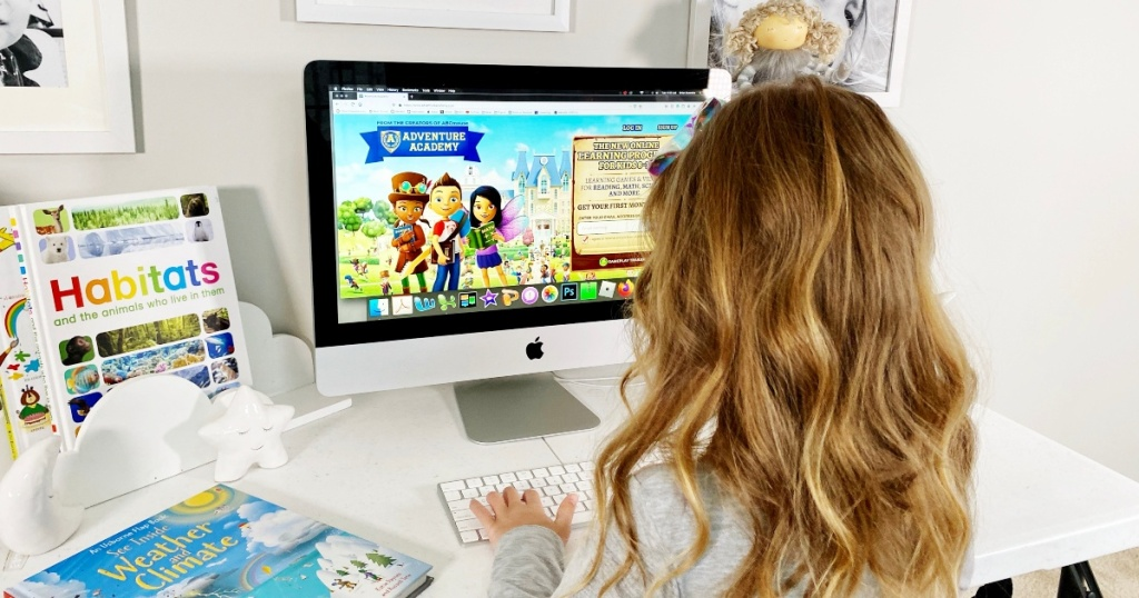 girl logging into Adventure Academy