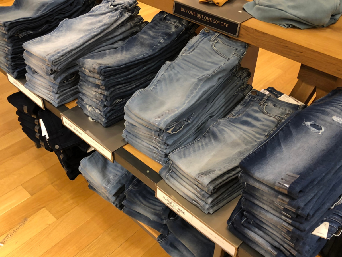 rows of jeans on store shelf