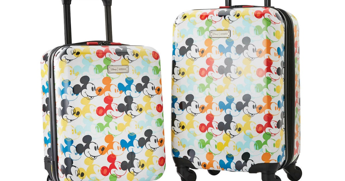 luggage featuring colorful mickey mouse cartoon faces