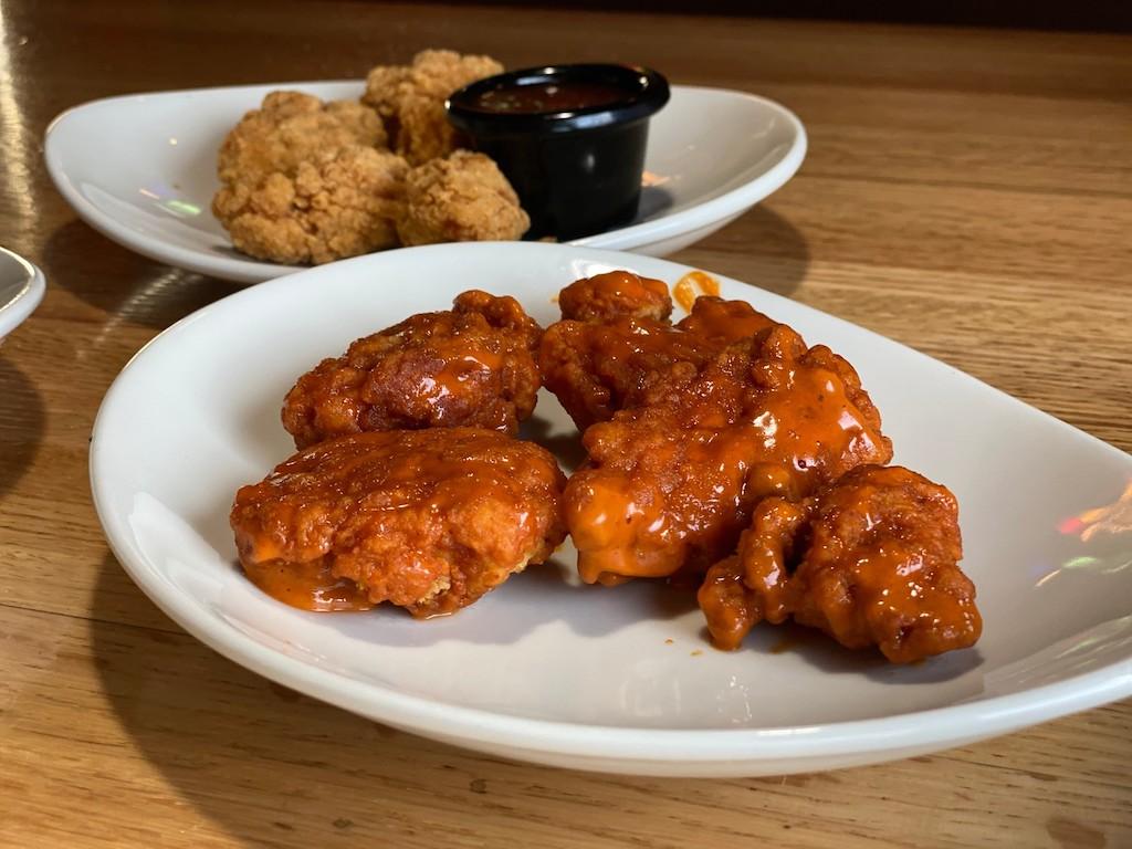 Applebee's wings on two plates