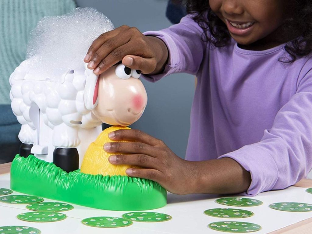 little girl playing with bubble blowing sheep game
