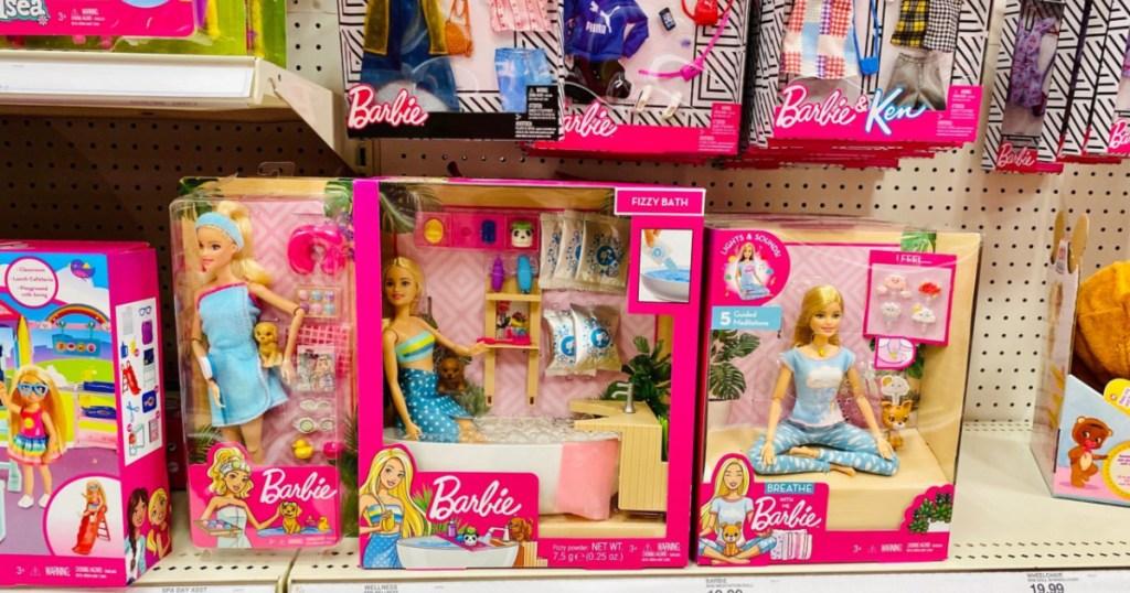 barbies on shelf