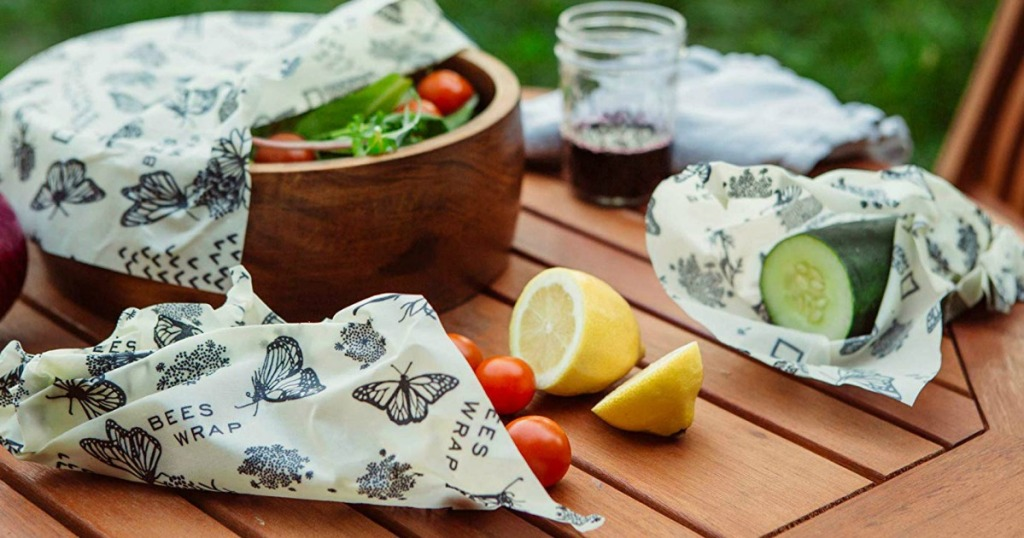 Beeswax wraps covering veggies on table
