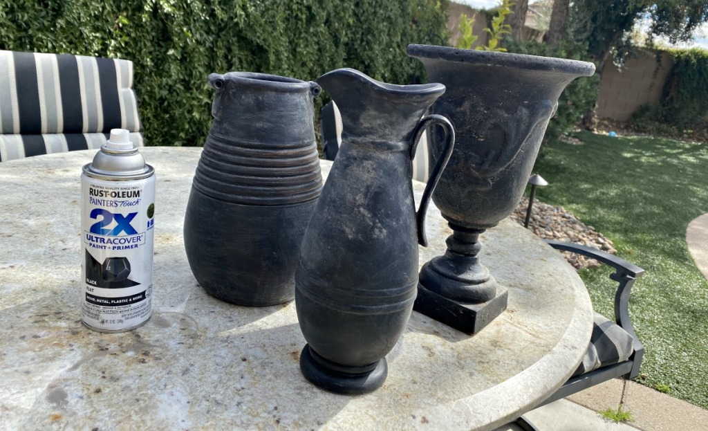 black pottery vases on a table