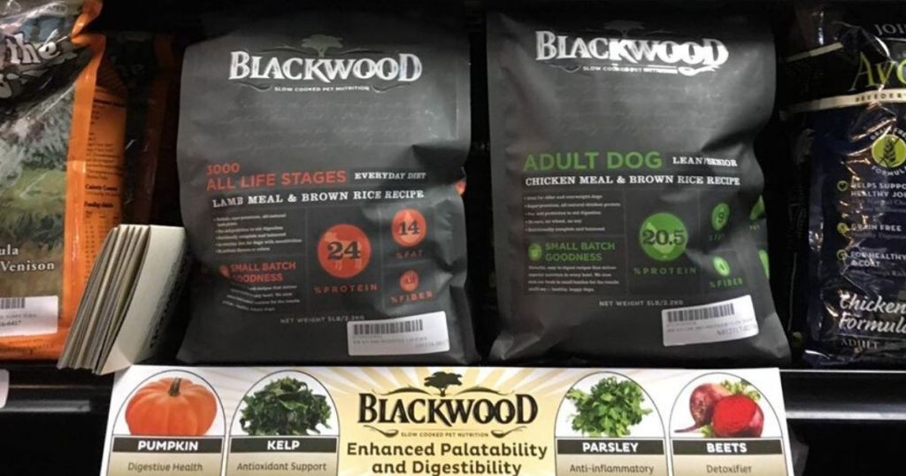 store shelf with two large bags of dog food on it
