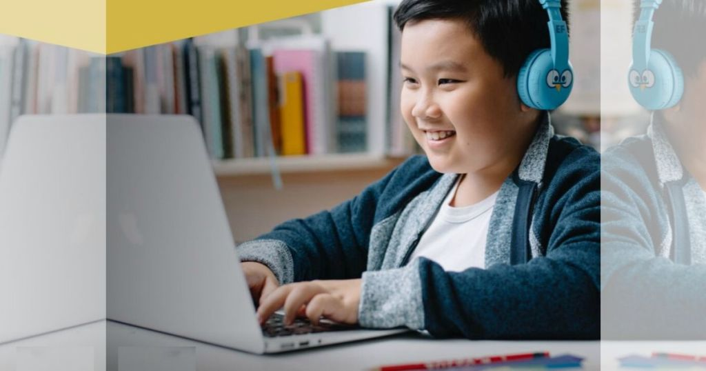 boy at computer with headphones on