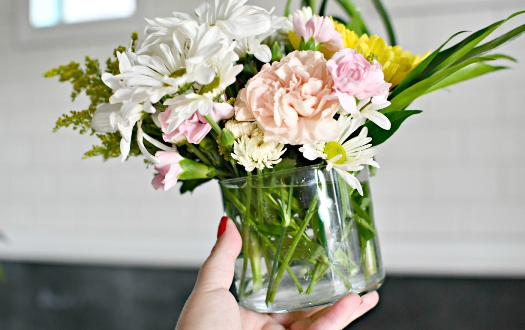 bath and bodyworks candle jar used as a vase