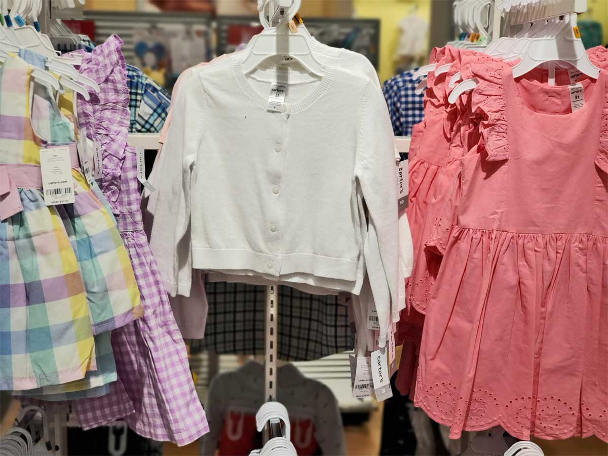 carters girls button up cardigan on display in a store