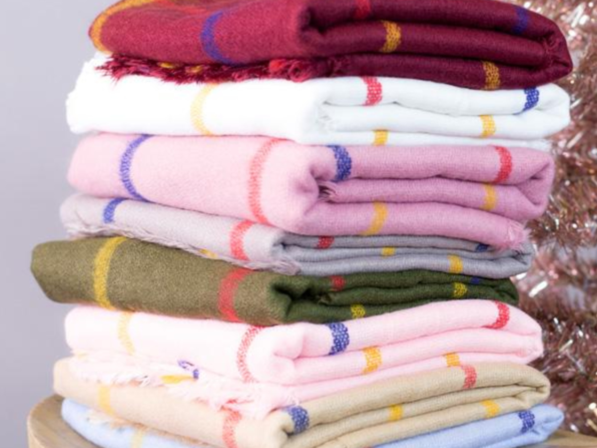 striped scarves in multiple colors folded and stacked