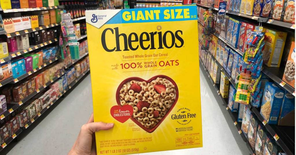 hand holding box of Cheerios at store
