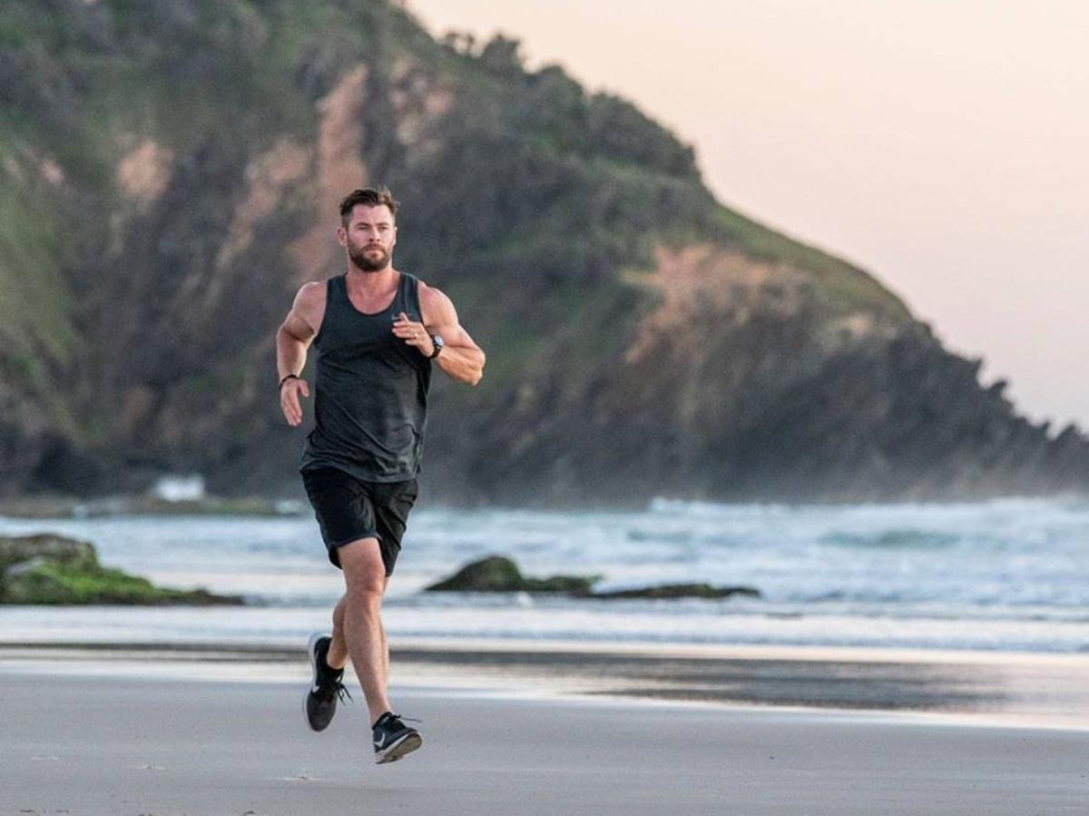 Chris Hemsworth running on beach