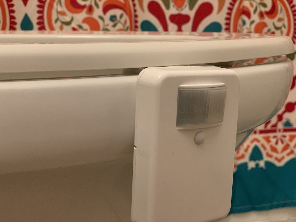 close up of motion light attached to toilet seat