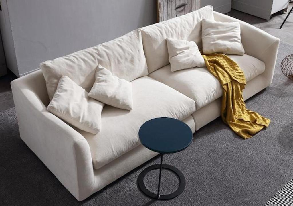 white couch with pillows in gray room