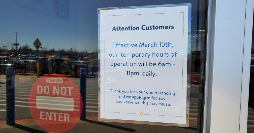 Sign indicating temporary hours at Walmart