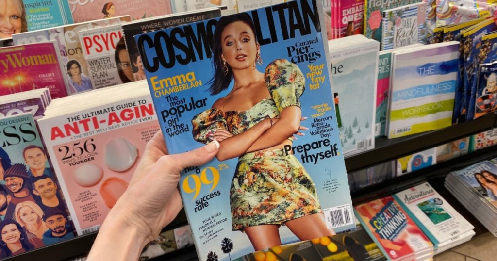 hand holding Cosmopolitan magazine