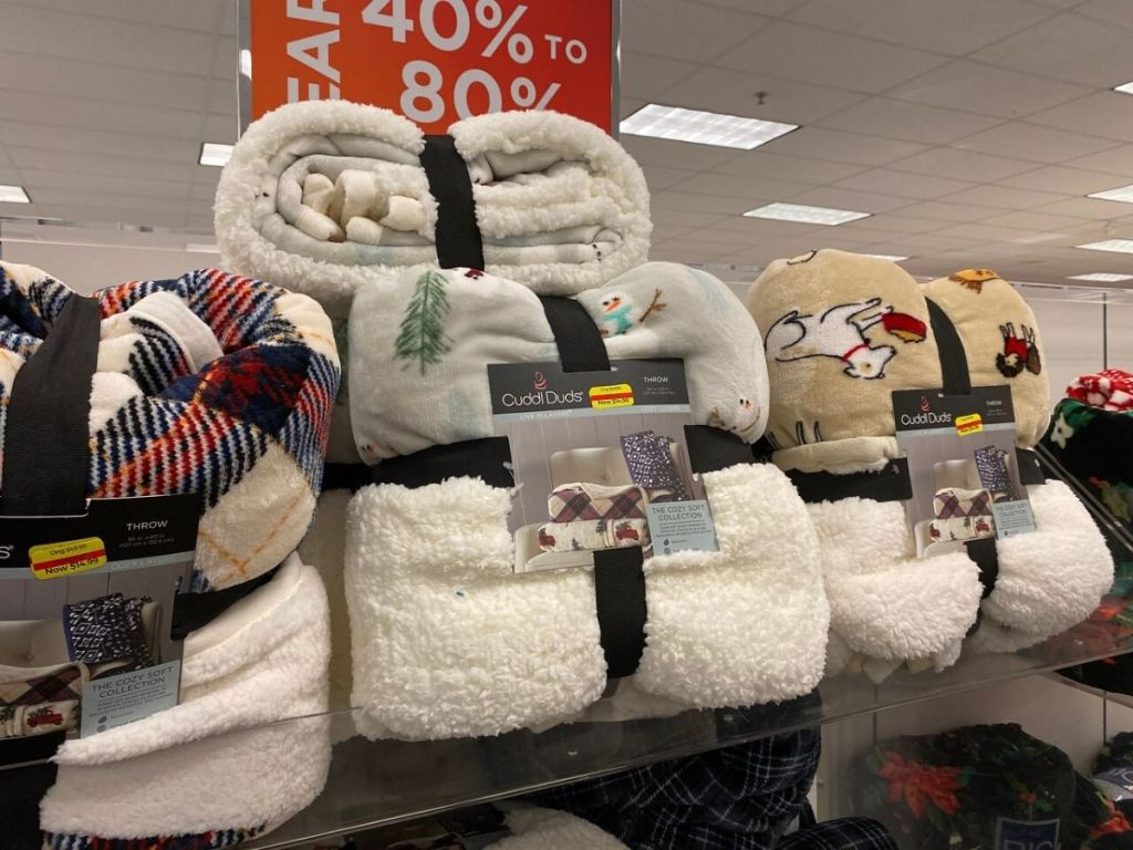 store display with stacked up sherpa blankets