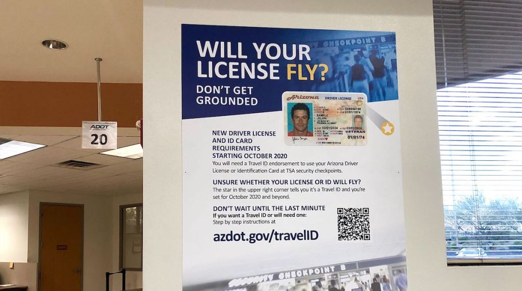 piece of paper on wall with information about license