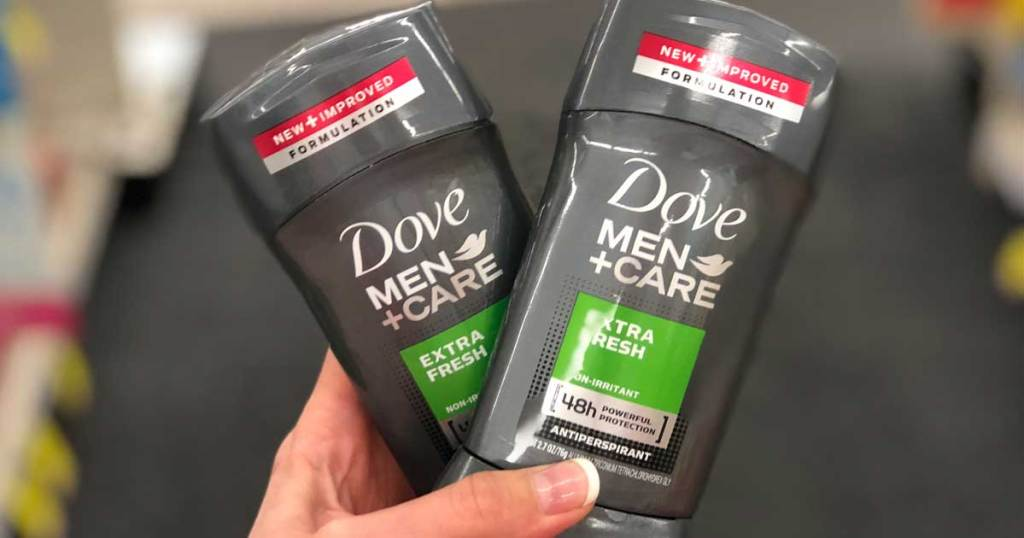 hand holding two dove men deodorants