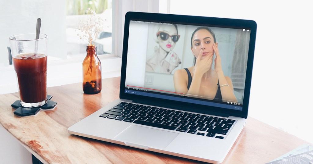 macbook laptop showing youtube video
