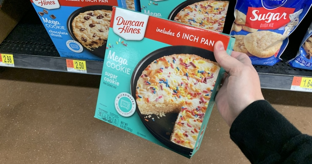 hand holding Duncan Hines Mega Cookie Kit at Walmart
