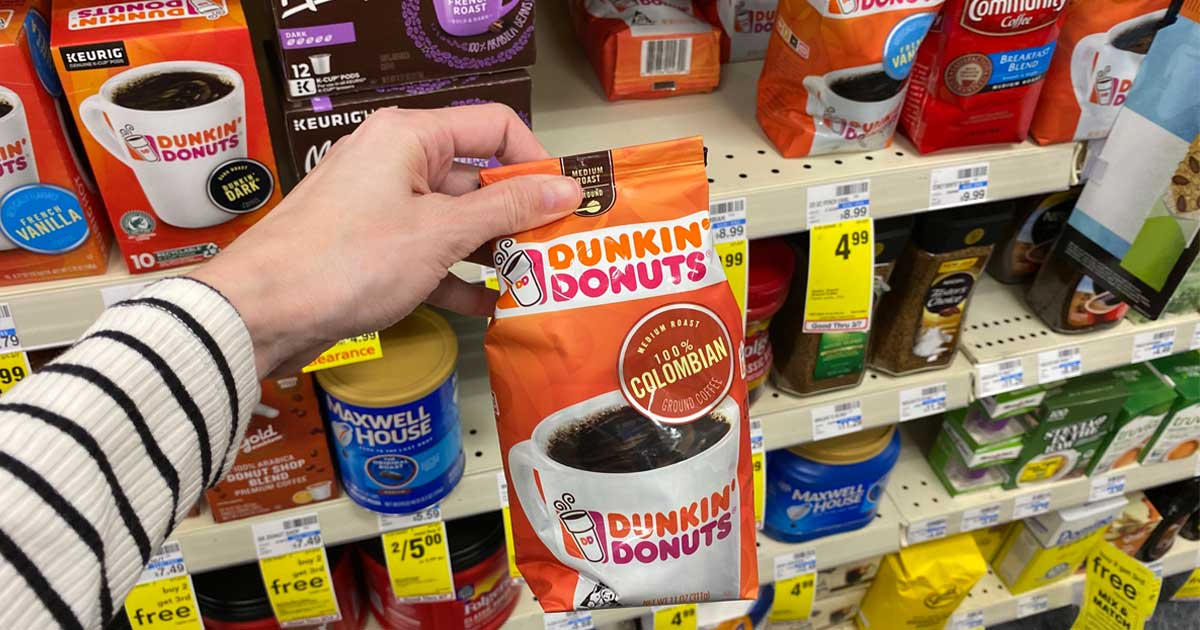 hand holding a bag of Dunkin Donuts coffee