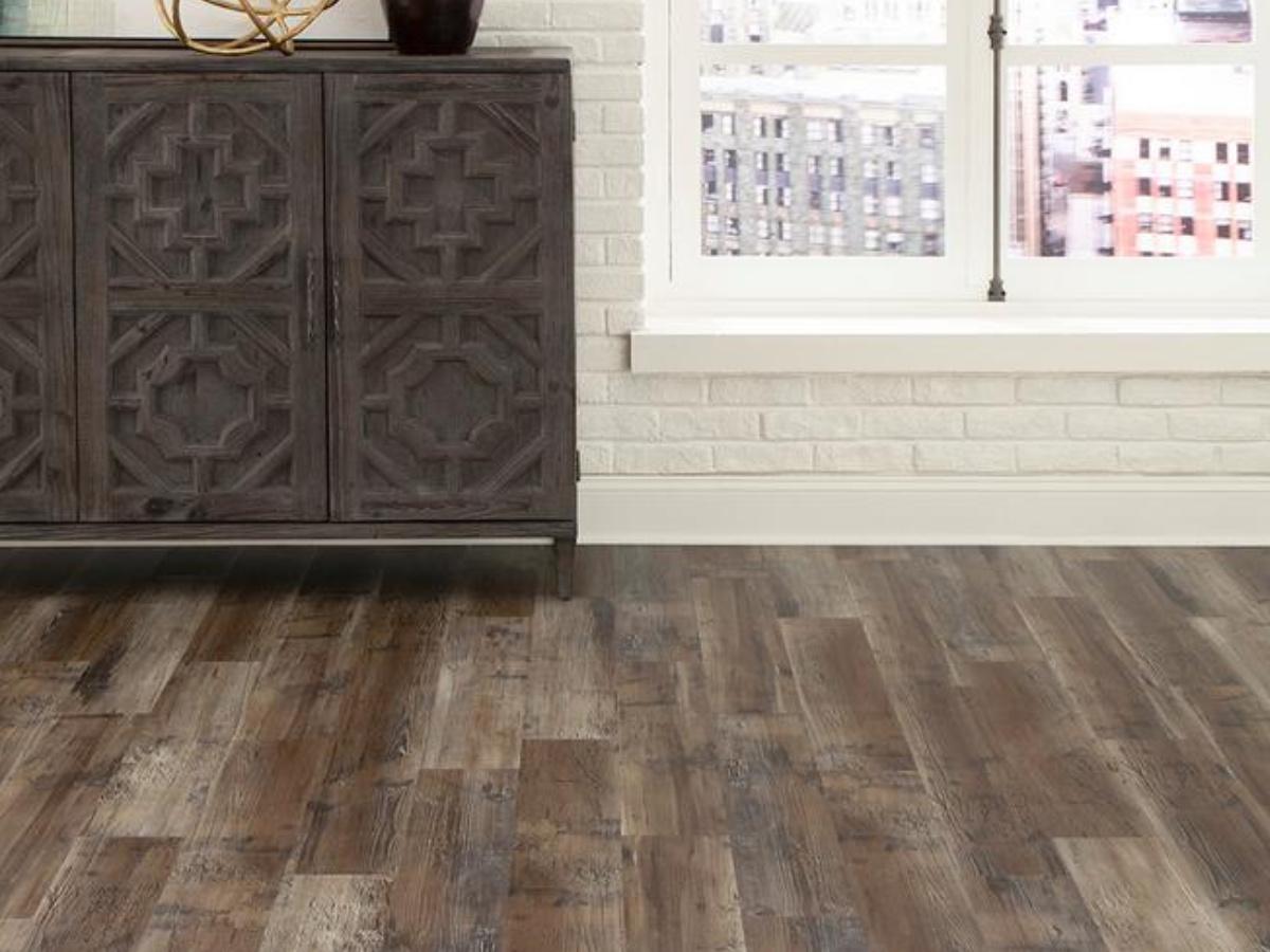 vinyl flooring with white brick wall