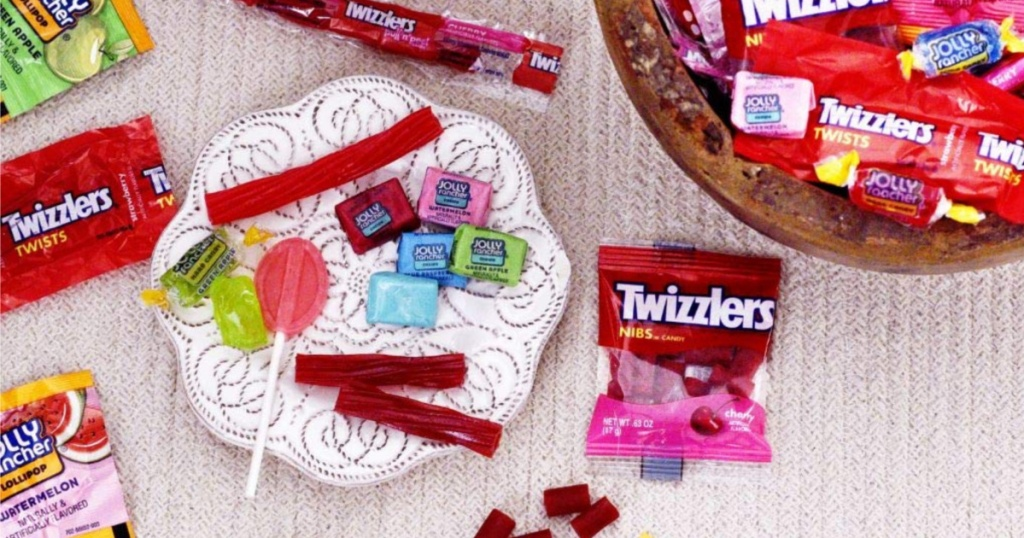 Twizzlers, jolly ranchers on plate and in bowl