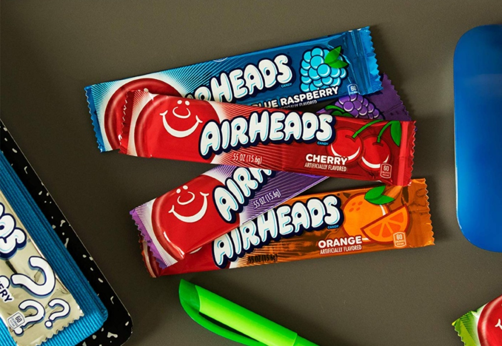 airheads sitting on desk with marker and mouse beside it