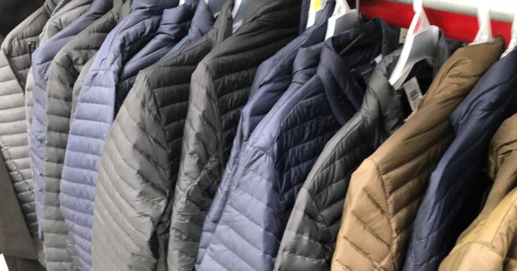 eddie bauer puffer jackets hanging in store