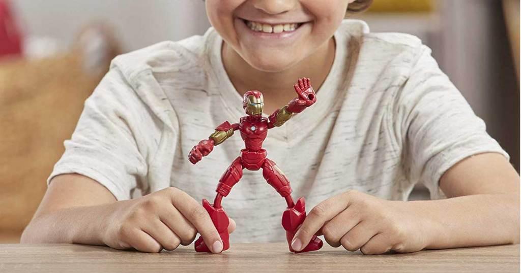 kid playing with iron man flex