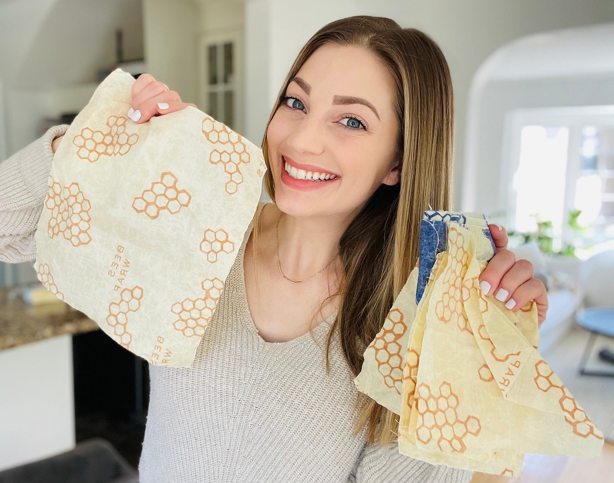 woman holding a handful of Bee's Wraps