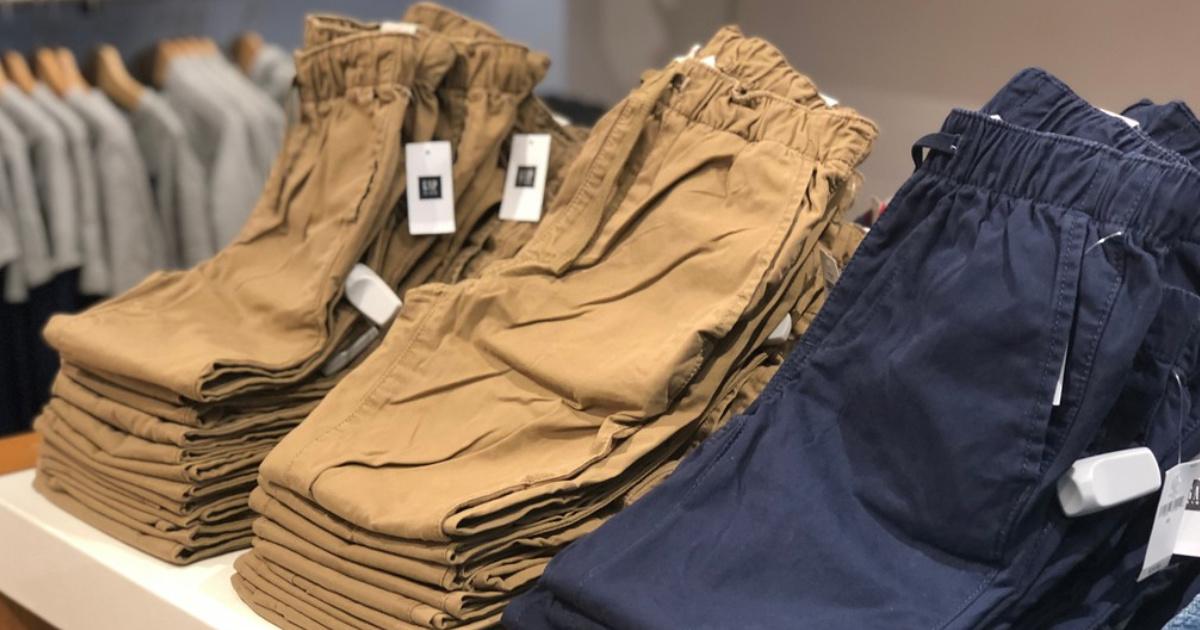 brown and blue gap kids pants on display in store