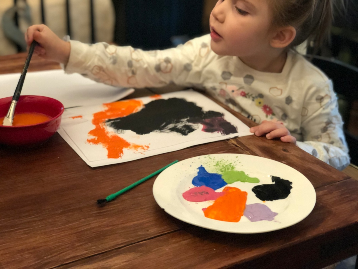 girl painting at table