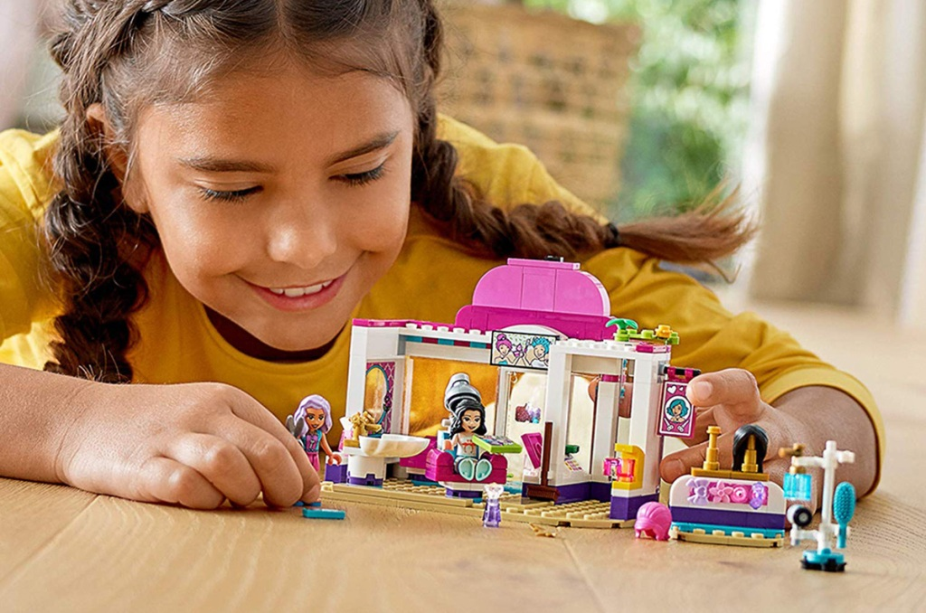 girl playing with lego hair salon set