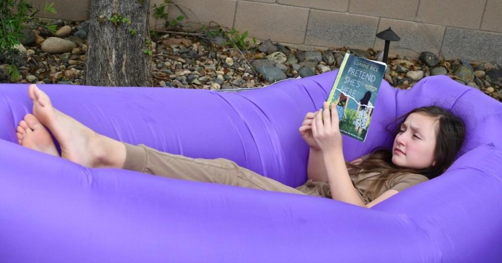 girl reading in an air sofa