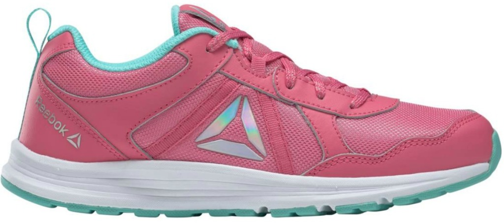pair of girls pink shoes with Reebok logo