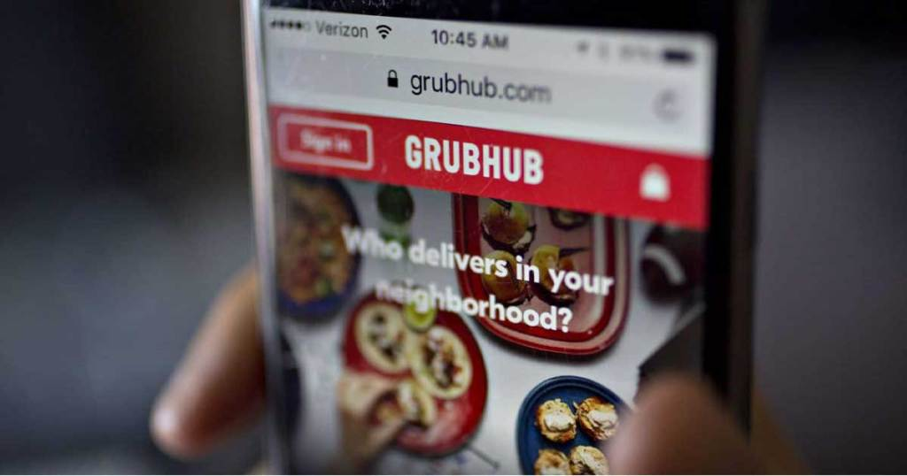 phone in hand with grubhub page up