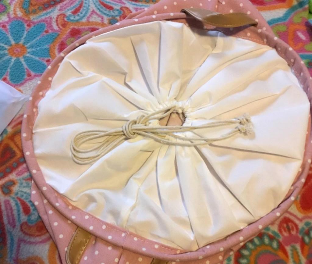 drawstring lid to pink hamper