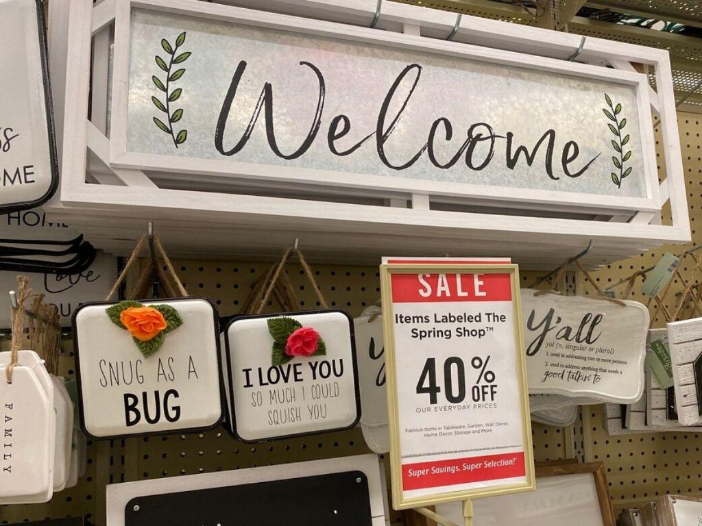 store display of metal wall signs