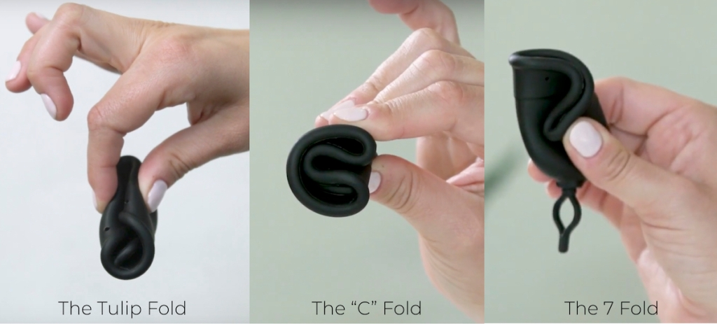 hand folding a black period cup three different ways
