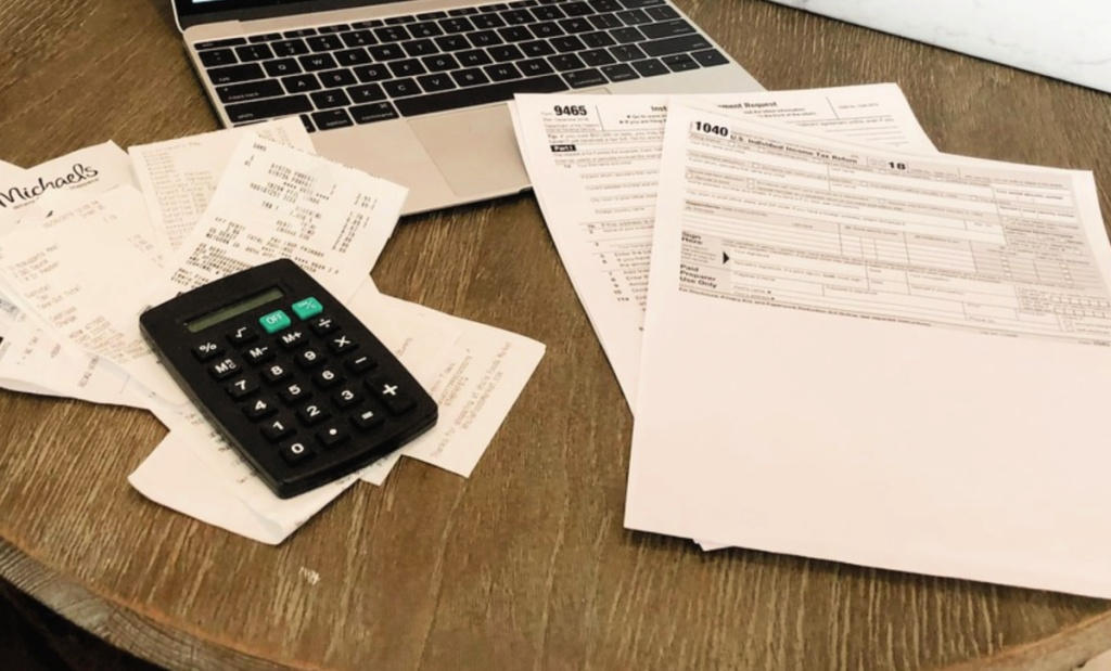 irs forms on desk with laptop and calculator