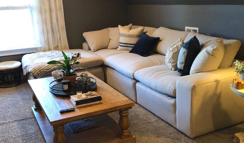 sectional couch in living room with wood coffee table